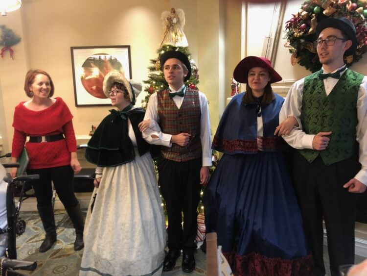 Christmas Carolers spreading holiday cheer