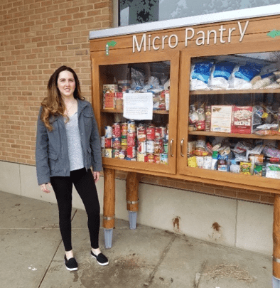 Ashley stalking up the Micro Food Pantry
